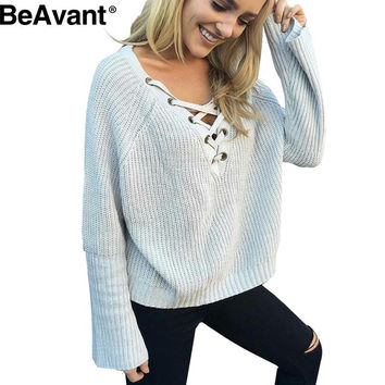 BeAvant Flare sleeve knitted sweater women 2016 Lace up V neck pullover Sexy pink jumpers Casual loose split knitwear outwear