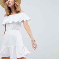 ASOS DESIGN Petite off shoulder sundress with tiered skirt at asos.com