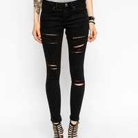 ASOS Whitby Low Rise Skinny Ankle Grazer Jeans in Washed Black with Extreme Rips