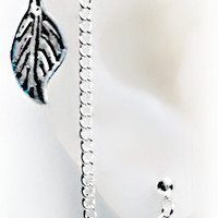 Double stud  leaf earring set chained to cartilage stud by earlums