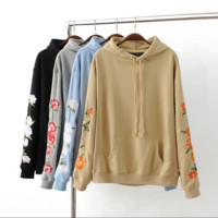 Autumn new women 's fashion wild flowers embroidered hooded loose head sweater coat women