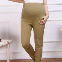Maternity maternity abdominal pants woven cotton color pencil pants Leggings Pants, the spring and autumn of pregnant women f023  Free Size = 1946467588