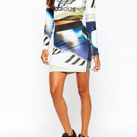 Adidas | adidas Mini Body-Conscious Skirt With 3 Stripes & All Over Shoe Chaos Print at ASOS