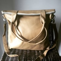 Genuine lambskin leather shoulder tote bag.Our Traveller bag is so unique.Long strap and stitched handles the perfect,lined shoulder bag