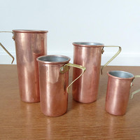 Tall thin copper measuring cups with brass handles, set of four copper nesting measuring cups