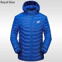NIKE 2018 winter new sports and leisure detachable hat warm down cotton padded clothes Royal blue