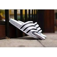 Adidas: slippers Black and white clover beach drag