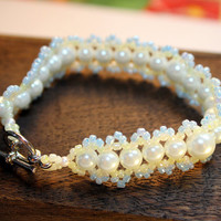 BLUEBERRY PEARLS BRACELET / beadwoven bracelet featuring cream glass pearls, light blue and yellow seed beads, & silver-plated toggle