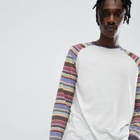 ASOS DESIGN relaxed long sleeve t-shirt with stripe raglan at asos.com