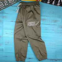 NIKE men and women with the same paragraph hollow embroidery big hook beam foot overalls F-AG-CLWM Green