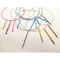 Pointed knitting needle pendant on cable