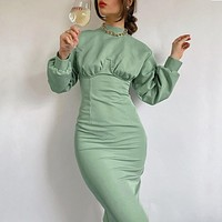 2020 new women's solid color long-sleeved round neck knitted slim-fit hip dress