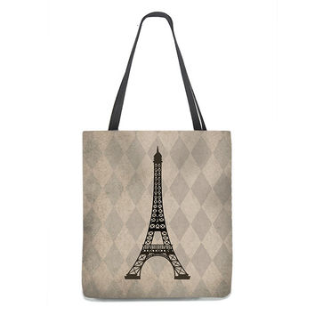 Eiffel Tower Tote Bag on rustic tan and taupe harlequin background