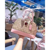 Coach fashion's new one-shoulder bag with strawberry shell in printed print for women Pink