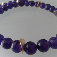 Necklace  handmade of faceted jade pearls amthyst color and gold colored metallic spacer