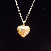 Vintage Filigree gold heart pendant on gold chain.