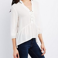 HIGH-LOW RUFFLE LACE-UP BLOUSE