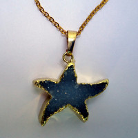 Gold plated druzy necklace in star design on gold tone chain.