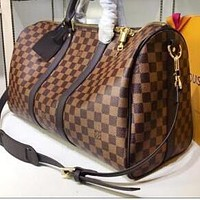 LV Louis Vuitton full-printed letters men and women large capacity duffel bag shoulder bag