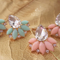 Lovely chic flower style stud statement earrings with clear rhinestones.