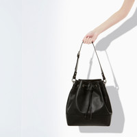 LEATHER BUCKET BAG WITH CUT WORK DETAIL