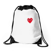 comme des garcons play Drawstring Bags