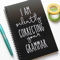 Writing journal, spiral notebook, bullet journal, black and white, sketchbook, blank lined or grid - I am silently correcting your grammar
