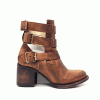Stay ultra stylish this season in these Chic Rolln Cut-Out Ankle Leather Bootie by Freebird by Steven! Featuring hand distressed leather upper and underlining, almond toe, side cut out design, three adjustable buckle straps, chunky stacked leather heel, st