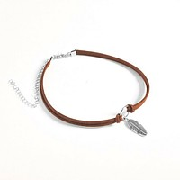 Brown Choker with Silver Circle and Feather Charm