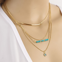 Faux Turquoise, Eye & Curved Bar Pendant Necklace