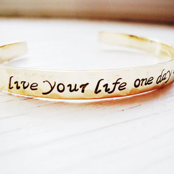 Live your life one day at a time hammered brass shiny cuff
