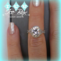 White Sapphire Engagement Ring 3.7ct Oval White Sapphire set in a 14k White Gold Diamond Halo Twist Shank Setting