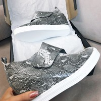 Zone Out Snakeskin Leather Wedge Sneaker