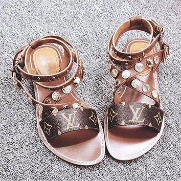 Louis Vuitton LV Buttoned flat-soled sandals