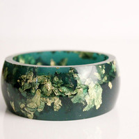 emerald green resin round bangle made with eco resin containing metallic gold leaf foil
