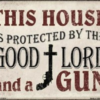 This House is Protected by the Good Lord and a Gun Metal Sign