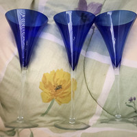 A Set of Three 11 Inch Blue Bowl Clear Long Stem Cocktail Glasses