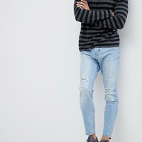 Pull&Bear Ripped Jeans In Carrot Fit In Mid Wash Blue at asos.com