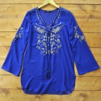 Marrakech Top - $66: One for the traveling queen, this sheer royal blue top plays well as a cover up. With intricate woven detailing.