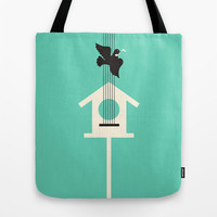 A bird stole my song Tote Bag by Budi Satria Kwan