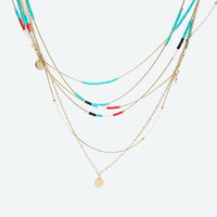Fine chain necklaces with coins