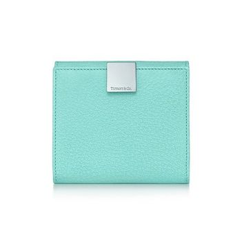 Tiffany & Co. -  French wallet in Tiffany Blue® textured leather. More colors available.