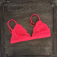 A Lace Bralette in Neon Coral