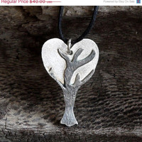 ON SALE Love heart necklace made of sterling silver and black cord. Tiny heart pendant