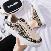 Fashionable light color shoes with snake pattern for women