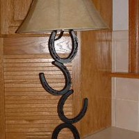 Kickin' Horse Shoe Creations - Western horseshoe and spur decor. Featuring horseshoe lamps, towel bars, candles with brands and wine holders.