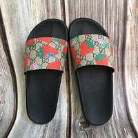 GG and Gucci strawberry print slippers