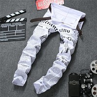 men jeans autumn Denim Pants Classic Newspaper letter printed casual slim trousers Cowboys Young Man fashion white jeans