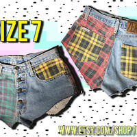 1990s Vintage GRUNGE worn in cut off high waist denim Zena hot shorts, red green yellow blue ire, distressed frayed 90s grunge fashion jeans