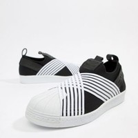 adidas Originals Superstar Slip On Sneakers In Black And White at asos.com